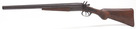 Coach Gun - Replica of 1881 double barrel shotgun used to defend  stagecoaches throughout the Old West frontier.